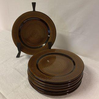 Graveren keramikk. Brun spiral.